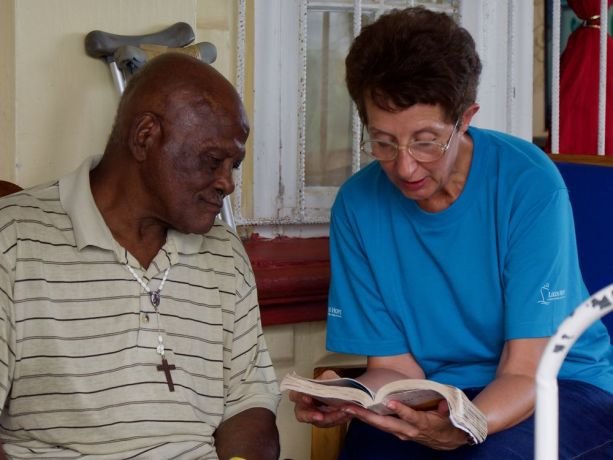 Grenada: Saint Georges, Grenada :: Sue De Villiers (South Africa) reads to a resident of an elderly care home. More Info