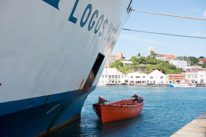 Grenada: Saint Georges, Grenada :: Crewmembers use a lifeboat to remove rust from Logos Hope. More Info