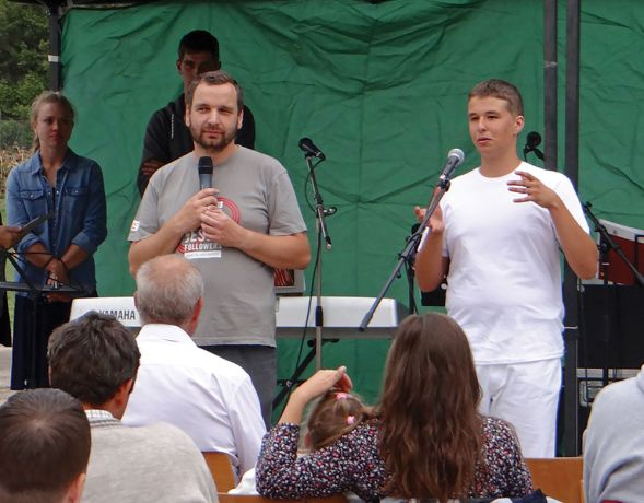 Hungary: Baseball player Dávid Hollós (right) shares his testimony before being baptised on the baseball field in Hungary in September 2017. Dávid came to faith through OM Hungary's sports ministry. More Info