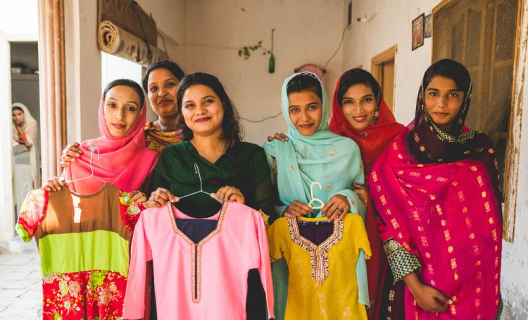 Pakistan: Trainees of a Sewing Centre in Pakistan display garments they made.