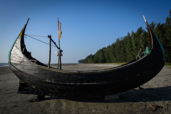 Bangladesh: Rohingya refugees used similar boats to these Bangladeshi fishing boats to cross the body of water separating Myanmar from Bangladesh. Photo by Garrett N More Info