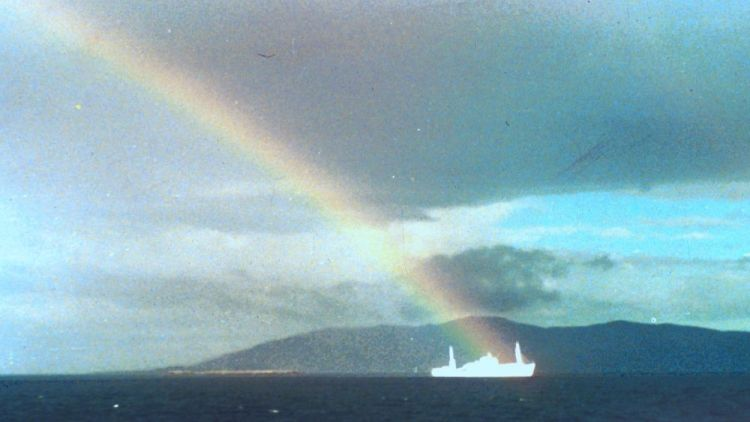 Ships: A rainbow streams over the wreck of Logos off the coast of Chile in January 1988. More Info