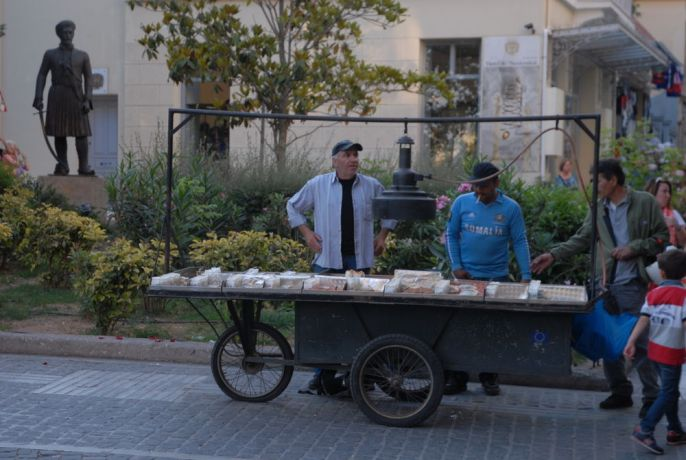 Greece: Photo of a man on a street in Athens, Greece selling nuts More Info