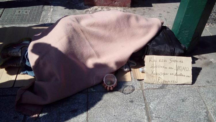 Greece: Photo of a homeless man on a street in Athens, Greece More Info