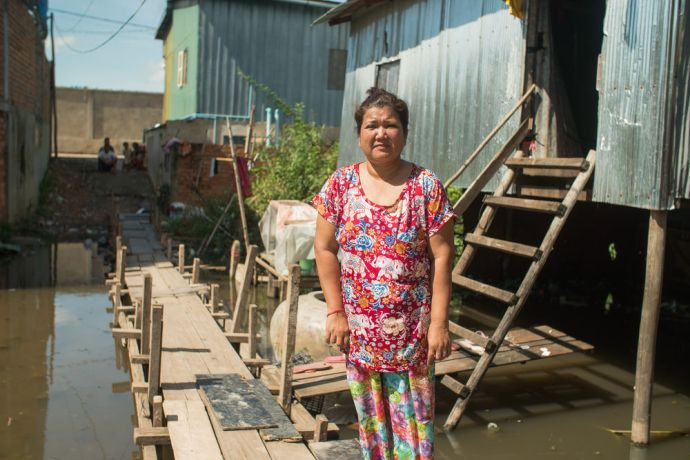 Cambodia: Srey Sina, who learned about Jesus from OM MTI, stands in front of her house in a slum in Cambodia. Photo by Jay More Info