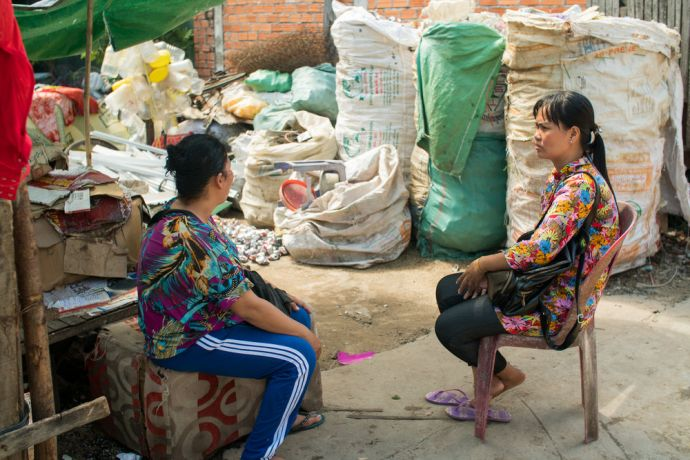 Cambodia: Mom Som, right, talks to a woman in a Cambodian slum as part of her work for OM MTI. More Info