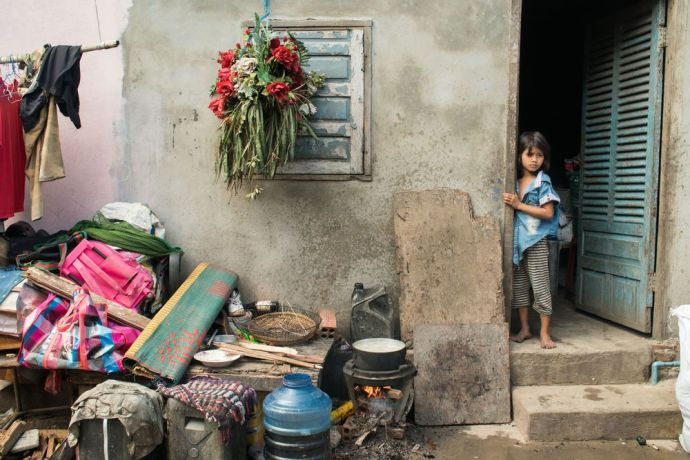 Cambodia: A young girl stands in a doorway of a house in a Cambodian slum. More Info