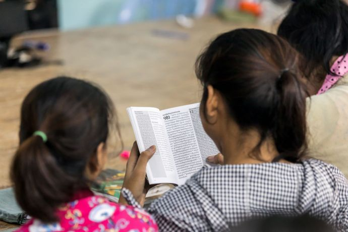 Cambodia: Employees at the VillageWorks factory in Cambodia spend two afternoons a week learning English through Gods Word. Photography by Adrian Green More Info