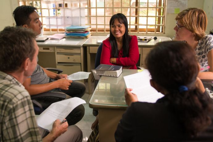 Cambodia: OM workers read the Bible and pray with Cambodian staff, encouraging them to look back and see Gods answers to prayer. Photo by Jay More Info