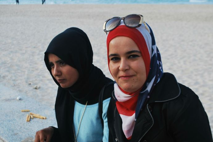 North Africa: Local women enjoy time with friends by the sea in North Africa.  Photo by Lauren OShea More Info