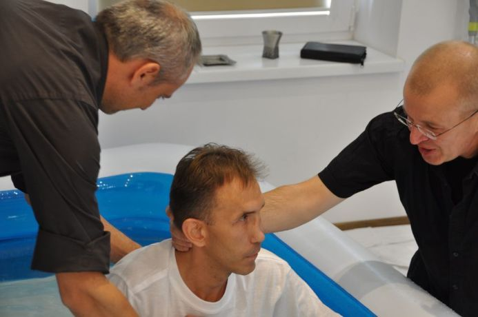 Poland: Kamil being baptised in Poland More Info