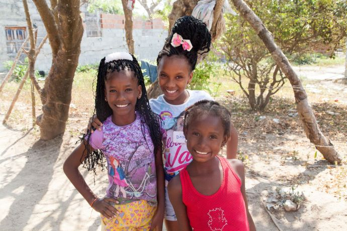 Colombia: Cartagena, Colombia :: Three girls smile for the camera. More Info