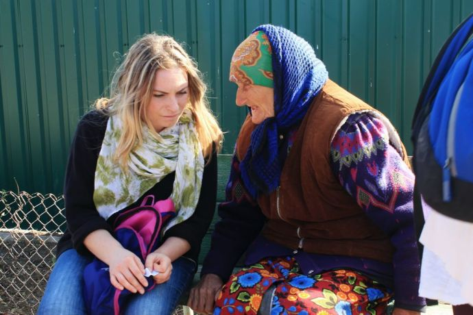 "Moldova: A Moldovan OM worker speaks to an old lady during an outreach that was part of OM Moldova's ""Challenge into Missions"" programme. This 10-week training course offers young Moldovans their first experience of missions. More Info"