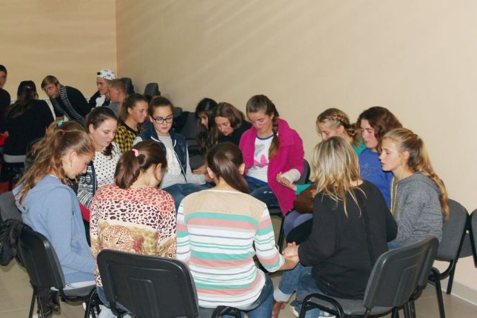 "Moldova: Participants of OM Moldova's ""Challenge into Missions"" training pray with young people during a youth meeting they led as part of an outreach in a Moldovan village. The 10-week training course offers young Moldovans their first experience of missions. Seeing how God can use them, many participants are mobilised to continue in local or global missions. More Info"