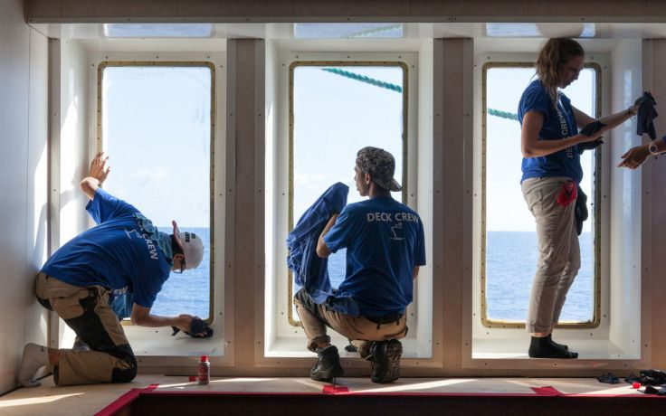 Colombia: At Sea :: Crewmembers grease the windows of Logos Hope. More Info
