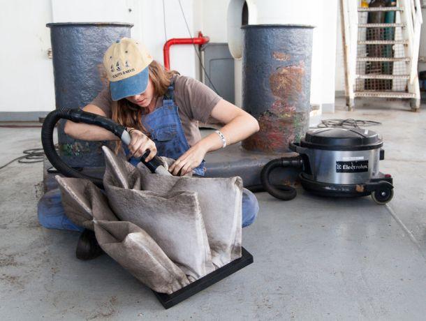 Colombia: At Sea :: Gabbie McBride (Australia) cleans equipment on deck. More Info