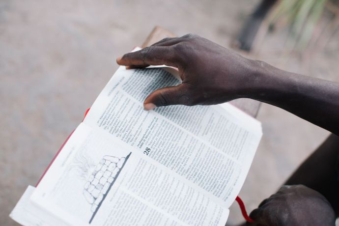International: Man reads a Bible. More Info