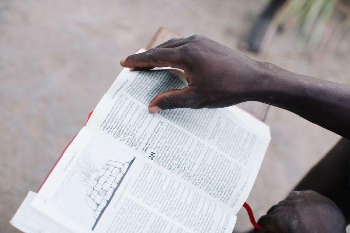 International: Man reads a Bible. More Info