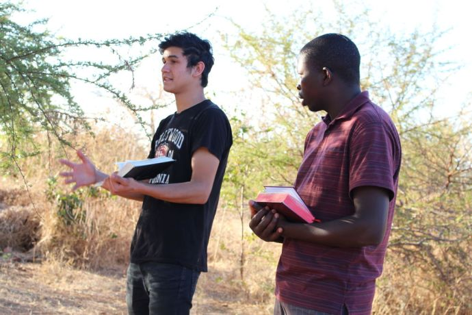 Zimbabwe: Visiting preacher share the gospel with an OMer interpreting the message More Info