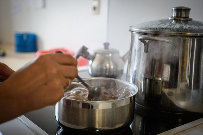 Austria: Making tea for a visiting friend after finding a place to live in peace More Info