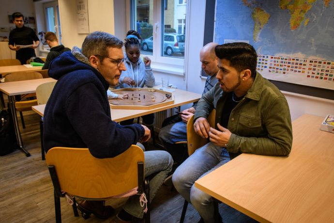 Austria: Talking with refugees in an international café. More Info