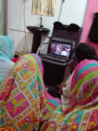 Pakistan: A group of women watch the JESUS film in a beauty salon. More Info