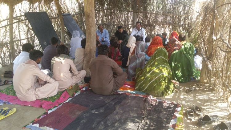 Pakistan: A group of Sindhi believers worshiping. More Info