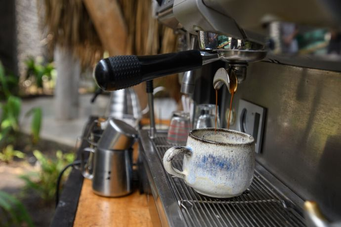 South East Asia: A huge part of the Latin American culture is enjoying coffee with friends. The coffee prepared here in locally made pottery on the coast of El Salvador.  Photo by Garrett N More Info