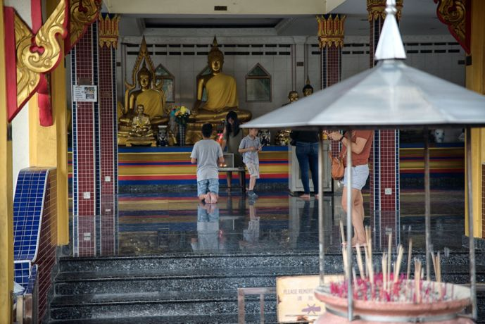 Malaysia: Thai Buddhist Praying at a Temple. More Info