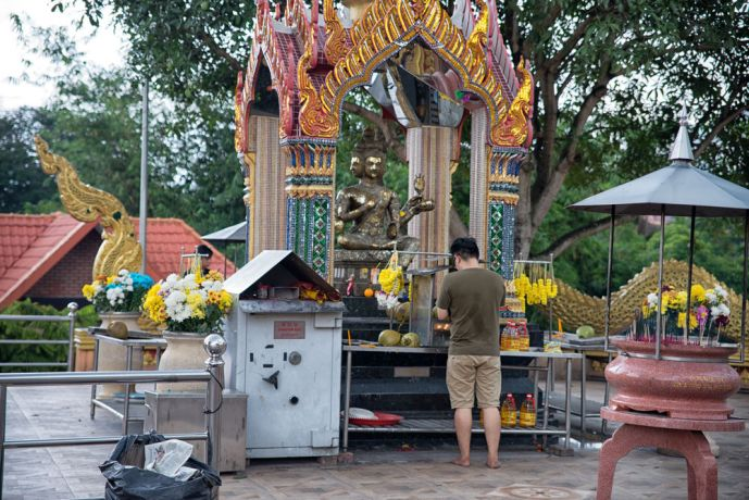 Malaysia: Buddhist praying at an outdoor shrine in a temple complex. More Info