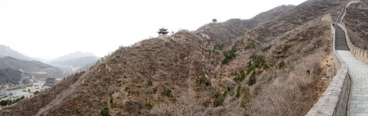 China: Great Wall of China, north of Beijing. Confucian Shrines along the hillside in the distance. More Info