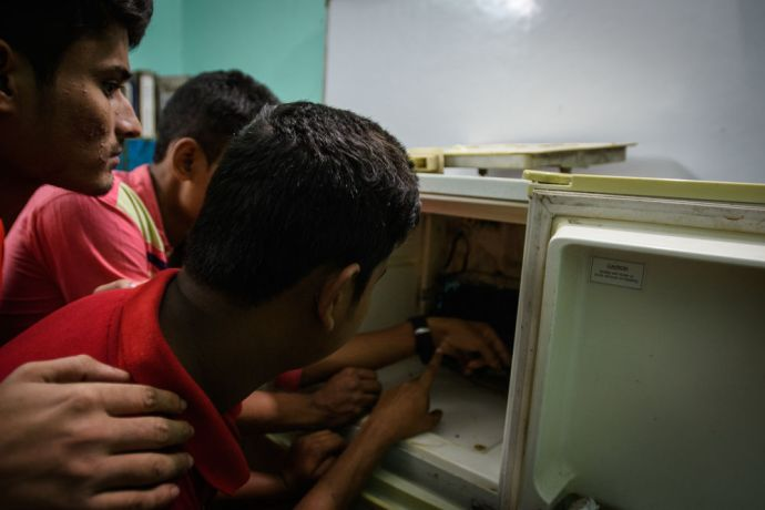 Bangladesh: Young men in a slum in Bangladesh are taught technical skills such as refrigeration and air conditioning. Following the training course, some young men go on to secure better opportunities for employment or start their own business. Photo by Garrett N More Info