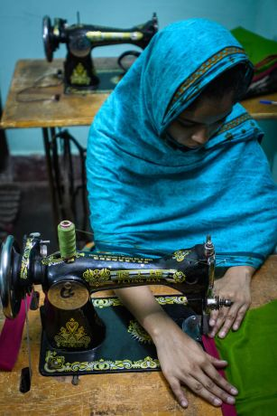 Bangladesh: Young women living in a slum in Bangladesh have the opportunity to learn a technical skill like sewing, enabling them to earn a living. Photo by Garrett N More Info