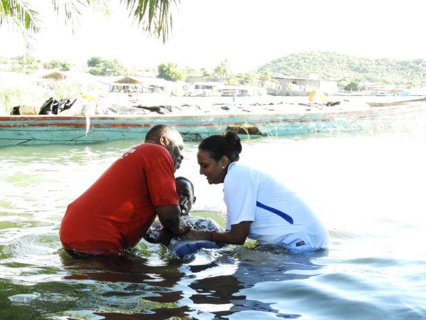 Zambia: A young believer is baptized at Lake Tanganyika, Zambia. More Info