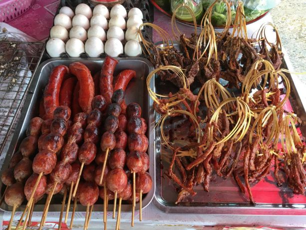 Laos: Street Stall selling a variety of local foods. More Info