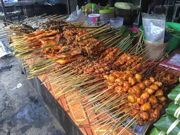 Laos: Marketplace stall selling skewered meats. More Info