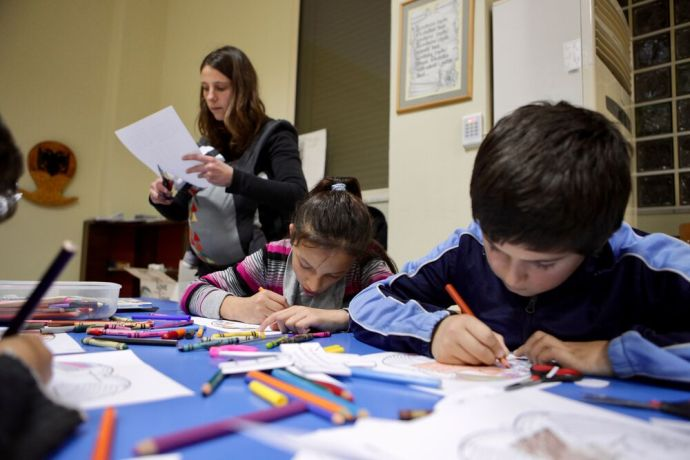 Albania: Its cutting and colouring time at the evangelistic programme (Sweet Mess) that OM Albania and a local church run for those with special needs and their families. More Info