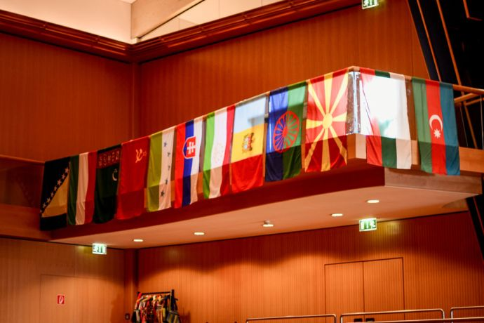 International: Flags at OM EASTs 50th Anniversary Celebration. More Info