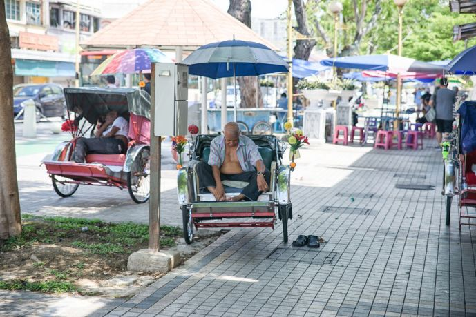 Malaysia: The drivers of Trishaws, Malaysias less known cousin to the Chinese Rickshaw, sleeping during the heat of the day. More Info