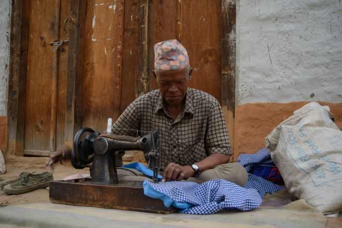 Nepal: A seamster at work in the streets of a remote village in Nepal.  Photo by Garrett N More Info