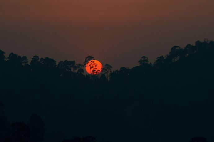 Nepal: The sun sets behind the hills in Nepal. More Info