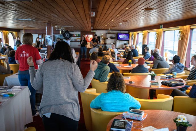 Netherlands: Worship on the river boat is an integral part of life.  Photo by Garrett N More Info