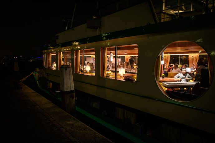Netherlands: Life on the riverboat at night.  Photo by Garrett N More Info