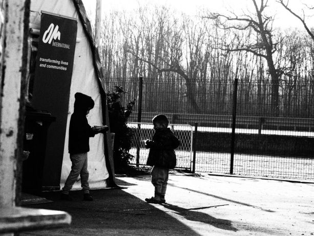 Serbia: Young children outside the OM tent at the refugee camp on the Serbian border More Info
