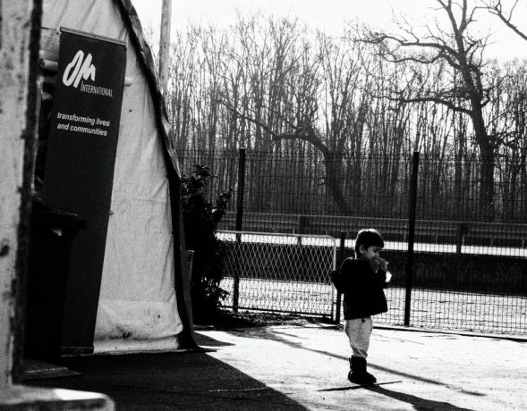 Serbia: Young child outside the OM tent at the refugee camp on the Serbian border More Info