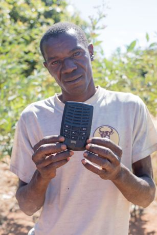 Mozambique: A man holds up his solar-powered audioBible which contains the Bible in ChiYao. More Info