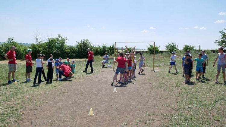 Ukraine: OM team members play with children during a Bus4Life outreach in Ukraines Odessa region. More Info