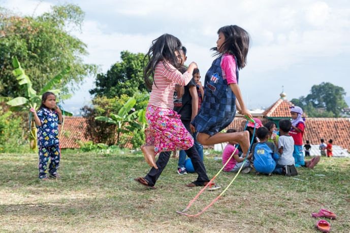 Indonesia: Children playing with a jump rope on the common grounds of a poor village in Indonesia. More Info