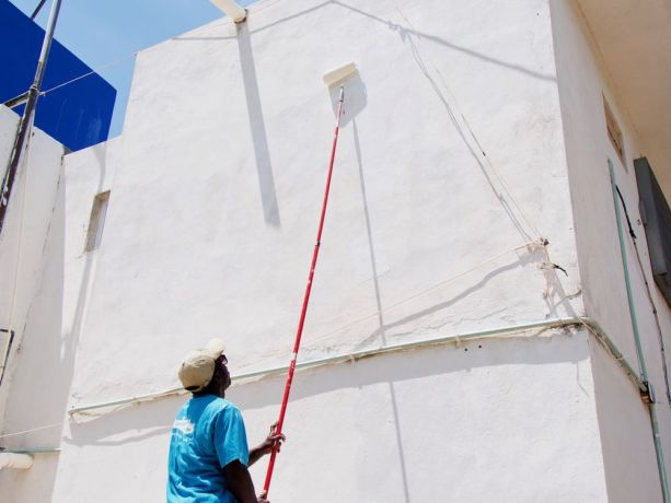Mexico: Progreso, Mexico :: Jean-Claude Mathieu (Haiti) paints the wall of a community centre. More Info