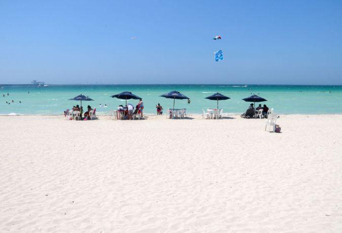 Mexico: Progreso, Mexico :: Families relax on the beach. More Info